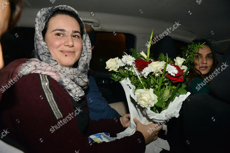 The pardoned Moroccan journalist Hajar Raissouni (L) holds a bouquet of flowers after her release, in Rabat, Morocco, 16 October 2019. King Mohammed VI of Morocco pardoned journalist Hajar Raissouni and all those sentenced on 30 September in connection with the journalist's alleged abortion case. Raissouni was sentenced in a Rabat court on 30 September to one year in jail for an 'illegal' abortion and sexual relations outside marriage.
