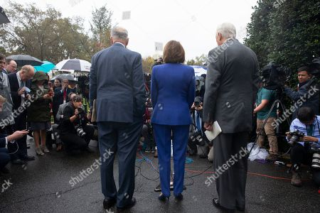 US Speaker of the House Democrat Nancy Pelosi (C), Senate Minority Leader Democrat Chuck Schumer (L), and House Majority Leader Democrat Steny Hoyer (R) deliver remarks to members of the news media outside the West Wing of the White House following a meeting between US President Donald J. Trump and Congressional leaders, in Washington, DC, USA, 16 October 2019. Trump met with Congressional leaders to discuss the US withdrawal from Syria.