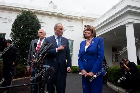 US Speaker of the House Democrat Nancy Pelosi (R), Senate Minority Leader Democrat Chuck Schumer (C), and House Majority Leader Democrat Steny Hoyer (L) deliver remarks to members of the news media outside the West Wing of the White House following a meeting between US President Donald J. Trump and Congressional leaders, in Washington, DC, USA, 16 October 2019. Trump met with Congressional leaders to discuss the US withdrawal from Syria.