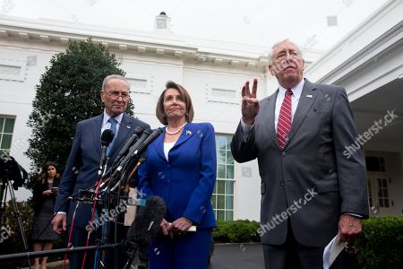 Stock Photo of US Speaker of the House Democrat Nancy Pelosi (C), Senate Minority Leader Democrat Chuck Schumer (L), and House Majority Leader Democrat Steny Hoyer (R) deliver remarks to members of the news media outside the West Wing of the White House following a meeting between US President Donald J. Trump and Congressional leaders, in Washington, DC, USA, 16 October 2019. Trump met with Congressional leaders to discuss the US withdrawal from Syria.