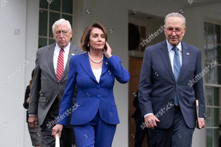 US Speaker of the House Democrat Nancy Pelosi (C), Senate Minority Leader Democrat Chuck Schumer (R), and House Majority Leader Democrat Steny Hoyer (L) walk out to deliver remarks to members of the news media outside the West Wing of the White House following a meeting between US President Donald J. Trump and Congressional leaders, in Washington, DC, USA, 16 October 2019. Trump met with Congressional leaders to discuss the US withdrawal from Syria.