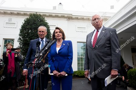 Stock Picture of US Speaker of the House Democrat Nancy Pelosi (C), Senate Minority Leader Democrat Chuck Schumer (L), and House Majority Leader Democrat Steny Hoyer (R) deliver remarks to members of the news media outside the West Wing of the White House following a meeting between US President Donald J. Trump and Congressional leaders, in Washington, DC, USA, 16 October 2019. Trump met with Congressional leaders to discuss the US withdrawal from Syria.