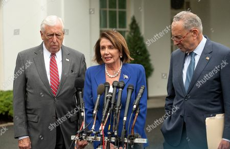 Speaker of the United States House of Representatives Nancy Pelosi (Democrat of California), center, speaks to reporters after a meeting with US President Donald J. Trump, with US House Majority Leader Steny Hoyer (Democrat of Maryland) and (right) US Senate Minority Leader Chuck Schumer (Democrat of New York).