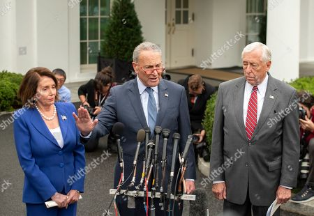 United States Senate Minority Leader Chuck Schumer (Democrat of New York), center, speaks to reporters after a meeting with US President Donald J. Trump, with (left) Speaker of the US House of Representatives Nancy Pelosi (Democrat of California) and (right) US House Majority Leader Steny Hoyer (Democrat of Maryland).