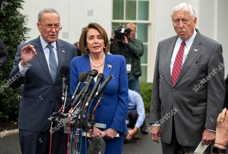 Speaker of the United States House of Representatives Nancy Pelosi (Democrat of California), center, speaks to reporters after a meeting with US President Donald J. Trump with (left) US Senate Minority Leader Chuck Schumer (Democrat of New York) and (right) US House Majority Leader Steny Hoyer (Democrat of Maryland).