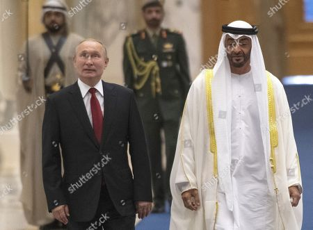 Stock Picture of Talks between Russian President Vladimir Putin and the Crown Prince of the Emirate of Abu Dhabi and Deputy Supreme Commander of the United Arab Emirates Armed Forces Crown Prince Sheikh Mohammed bin Zayed Al Nahyan took place in the Qasr Al Watan palace. Russian President Vladimir Putin, left, and the Crown Prince of the Emirate of Abu Dhabi and Deputy Supreme Commander of the United Arab Emirates Armed Forces Crown Prince Sheikh Mohammed bin Zayed Al Nahyan, right, during the official welcoming ceremony.