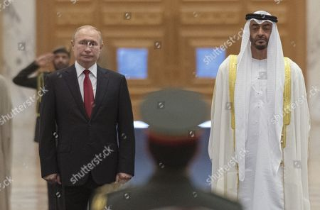 Stock Image of Talks between Russian President Vladimir Putin and the Crown Prince of the Emirate of Abu Dhabi and Deputy Supreme Commander of the United Arab Emirates Armed Forces Crown Prince Sheikh Mohammed bin Zayed Al Nahyan took place in the Qasr Al Watan palace. Russian President Vladimir Putin, left, and the Crown Prince of the Emirate of Abu Dhabi and Deputy Supreme Commander of the United Arab Emirates Armed Forces Crown Prince Sheikh Mohammed bin Zayed Al Nahyan, right, during the official welcoming ceremony.