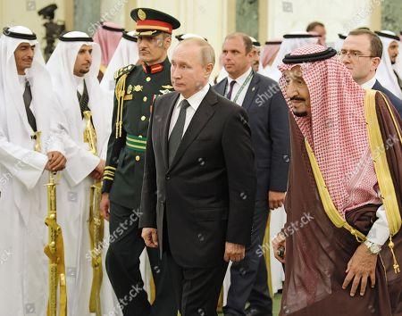 Stock Image of Russian President Vladimir Putin, centre, and Saudi Arabia's King Salman bin Abdulaziz Al Saud, right, during a meeting at the Royal Palace Complex.
