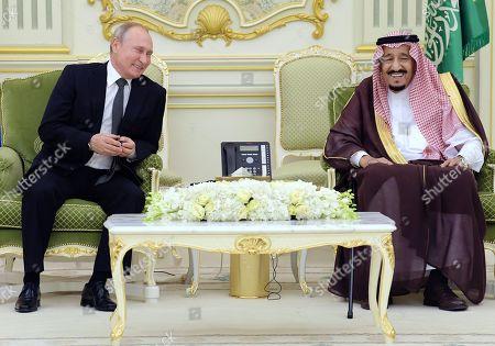 Russian President Vladimir Putin, left, and Saudi Arabia's King Salman bin Abdulaziz Al Saud, right, during a meeting at the Royal Palace Complex.