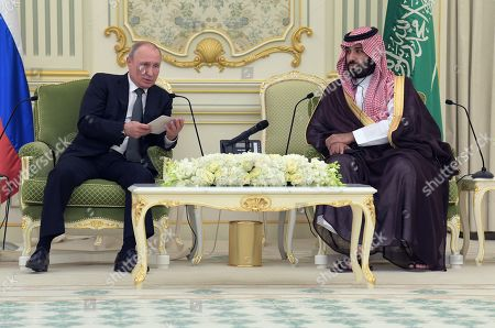 Russian President Vladimir Putin, left, and Crown Prince of Saudi Arabia Crown Prince Mohammad bin Salman bin Abdulaziz Al Saud during a meeting at the Royal Palace Complex.