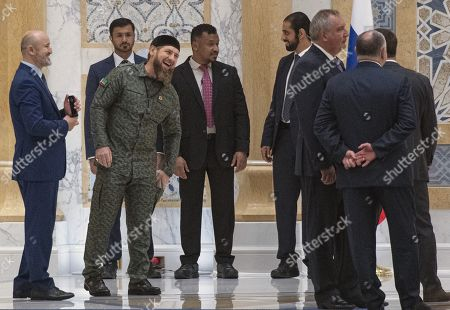 Talks between Russian President Vladimir Putin and the Crown Prince of the Emirate of Abu Dhabi and Deputy Supreme Commander of the United Arab Emirates Armed Forces Crown Prince Sheikh Mohammed bin Zayed Al Nahyan took place in the Qasr Al Watan palace. Head of the Chechen Republic Ramzan Kadyrov (third from left) and Roskosmos State Corporation for Space Activities General Director Dmitry Rogozin (third from right) before the official welcoming ceremony.