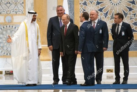 Stock Picture of Talks between Russian President Vladimir Putin and the Crown Prince of the Emirate of Abu Dhabi and Deputy Supreme Commander of the United Arab Emirates Armed Forces Crown Prince Sheikh Mohammed bin Zayed Al Nahyan took place in the Qasr Al Watan palace. From left: Crown Prince of the Emirate of Abu Dhabi and Deputy Supreme Commander of the United Arab Emirates Armed Forces Crown Prince Sheikh Mohammed bin Zayed Al Nahyan, Roscosmos State Space Corporation Director General Dmitry Rogozin, President of Russia Vladimir Putin and from right: Director General of Rosatom State Corporation Alexei Likhachev and Director General of Rosoboronexport Alexander Mikheev during the official welcoming ceremony.