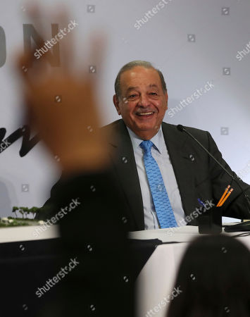 Mexican billionaire Carlos Slim smiles during a news conference at his office in Mexico City,. Slim says he supports President Andrés Manuel López Obrador's objectives