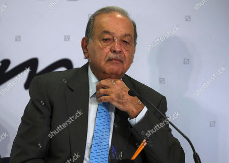 Mexican billionaire Carlos Slim listens to a question during a news conference at his office in Mexico City,. Slim says he supports President Andrés Manuel López Obrador's objectives