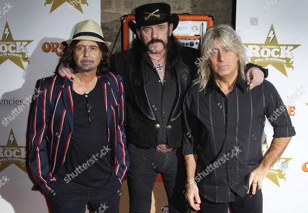 From left, Phil Campbell, Lemmy Kilmister, and Mikkey Dee, of Motorhead, at the Classic Rock Roll of Honour Awards at the Roundhouse venue in Camden, north London. Motorhead are among the 16 acts nominated for the Rock and Roll Hall of Fame's 2020 class. Kilmister died on on Dec. 28, 2015