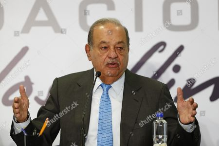 Mexican business magnate Carlos Slim shows a newspaper with a published article that relates national policy to the economic sector, during a press conference in Mexico City, Mexico, 16 October 2019. Slim whipped his competitors, the US AT&T and Spain's Telefonica for not investing or offering quality services and instead demanding a subsidy from one of his companies.