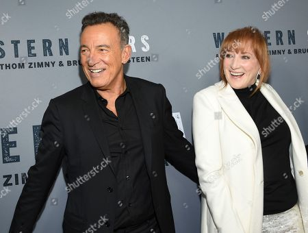"""Bruce Springsteen, Patti Scialfa. Singer-songwriter and co-director Bruce Springsteen, left, and wife Patti Scialfa attend the special screening of """"Western Stars"""" at Metrograph, in New York"""