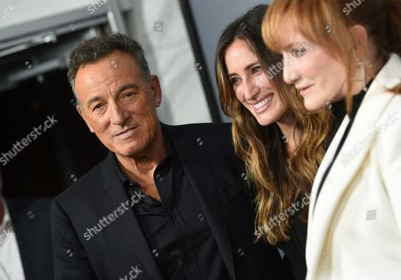 """Bruce Springsteen, Jessica Springsteen, Patti Scialfa. Singer-songwriter Bruce Springsteen, left, daughter Jessica Springsteen and wife Patti Scialfa arrive at the special screening of """"Western Stars"""" at Metrograph, in New York"""