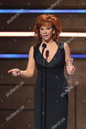 Reba McEntire accepts the Artist of a Lifetime award at 2019 CMT Artists of the Year at Schermerhorn Symphony Center, in Nashville, Tenn