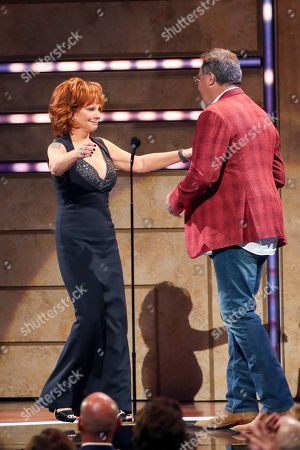 Reba McEntire, Vince Gill. Reba McEntire, left, accepts the Artist of a Lifetime award from Vince Gill at 2019 CMT Artists of the Year at Schermerhorn Symphony Center, in Nashville, Tenn