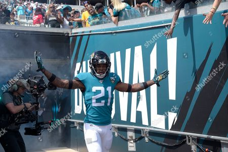 Jacksonville Jaguars cornerback A.J. Bouye (21) runs onto the field during player introductions before an NFL football game against the New Orleans Saints, in Jacksonville, Fla