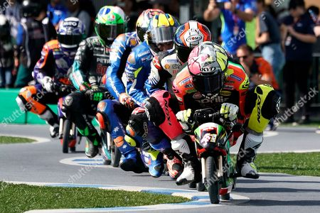 Spanish MotoGP rider Aleix Espargaro (R) of Aprilia Racing Team Gresini and other MotoGP racers ride mini electric motorcycles at a fan event at Twin Ring Motegi in Motegi, Japan, 17 October 2019. The event was held ahead of the MotoGP race of Japan's Motorcycling Grand Prix scheduled for 20 October 2019.