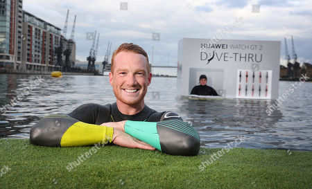 Greg Rutherford became the first visitor to a new 'Dive-Thru' on the waters of the Royal Victoria Dock, London.
