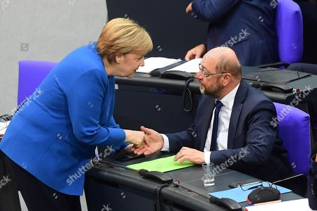 German Chancellor Angela Merkel (L) and former Social Democratic Party (SPD) chairman Martin Schulz talk at the German Bundestag in Berlin, Germany, 17 October 2019. Merkel delivered a government declaration to the members of the German parliament Bundestag prior to an EU summit in Brussels on 17 October 2019.