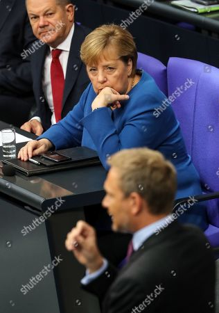 German Chancellor Angela Merkel (R) and Finance Minister Olaf Scholz listen to the chairman of the Free Democratic Party (FDP), Christian Lindner, during a session of the German parliament 'Bundestag' in Berlin, Germany, 17 October 2019. Merkel delivered a government declaration on the upcoming EU summit.