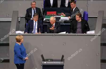 German Chancellor Angela Merkel (L) listens to the President of the German parliament, Wolfgang Schaeuble (C), during a session of the German parliament 'Bundestag' in Berlin, Germany, 17 October 2019. Merkel delivered a government declaration on the upcoming EU summit.