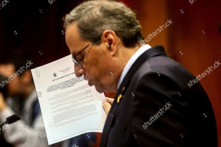 Catalan Regional President Quim Torra holds a report issued by Spanish Constitutional Court as he delivers a speech during a plenary session at regional Chamber in Barcelona, Catalonia, Spain, 17 October 2019. Torra appeared before the regional MPs to inform on deal with an answer to the Spanish Supreme Court's sentence against pro-independence leaders and the riots and protest held in the region last days.