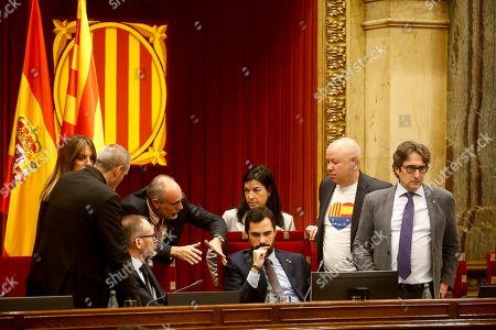 Catalan regional Parliament's Speaker Roger Torrent (C) is surrounded by chamber's board members and parliament's lawyers before the beginning of a plenary session at regional Chamber in Barcelona, Catalonia, Spain, 17 October 2019. Catalan regional President Quim Torra (unseen) appeared before the regional MPs to inform on deal with an answer to the Spanish Supreme Court's sentence against pro-independence leaders and the riots and protest held in the region last days.