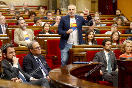 Pro-Spain Ciuadanos (Citizens) party's regional parliamentary Chairman, Carlos Carrizosa (C), delivers a speech next to Catalan Regional President, Quim Torra (2-L), during a plenary session at regional Parliament, in Barcelona, Catalonia, Spain, 17 October 2019. Torra appears before the regional MPs to inform on deal with an answer to the Spanish Supreme Court's sentence against pro-independence leaders and the riots and protest held in the region last days.