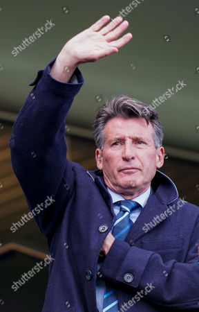 Lord Sebastian Coe waves from the stands at Stamford Bridge before kick-off