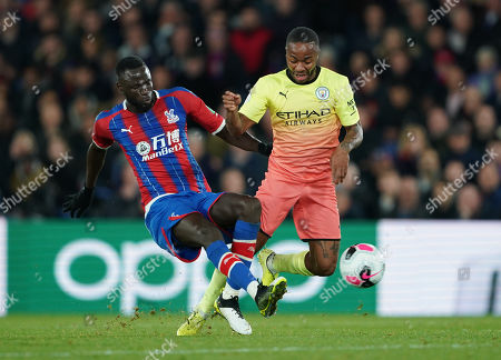 Cheikhou Kouyate of Crystal Palace tackles Raheem Sterling of Manchester City
