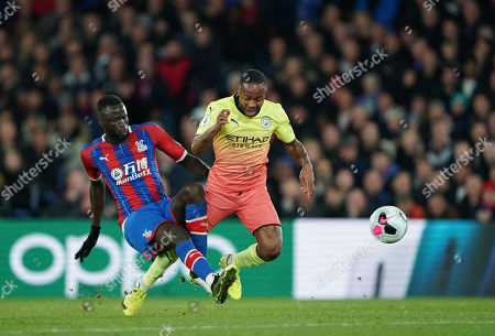 Stock Photo of Cheikhou Kouyate of Crystal Palace tackles Raheem Sterling of Manchester City