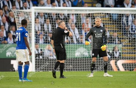 Stock Photo of Kasper Schmeichel goalkeeper  of Leicester City looks on as Referee Jonathan Moss disallows the goal by Chris Wood of Burnley after a VAR review
