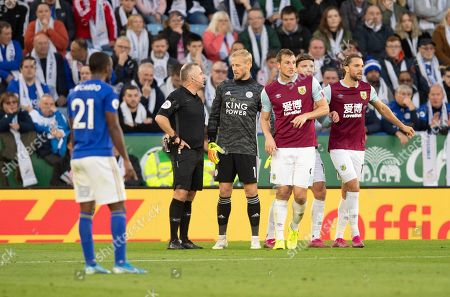 Stock Picture of Kasper Schmeichel goalkeeper  of Leicester City talks with Chris Wood of Burnley as Referee Jonathan Moss check VAR for confirmation of the goal by Chris Wood of Burnley