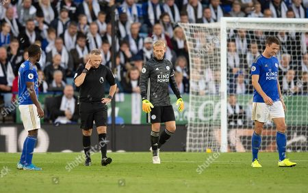 Kasper Schmeichel goalkeeper of Leicester City looks on as Referee Jonathan Moss checks VAR for confirmation of the goal by Chris Wood of Burnley