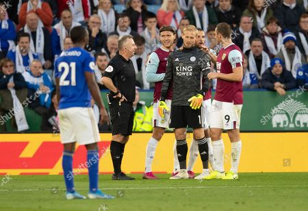 Kasper Schmeichel goalkeeper  of Leicester City talks with Chris Wood of Burnley as Referee Jonathan Moss check VAR for confirmation of the goal by Chris Wood of Burnley