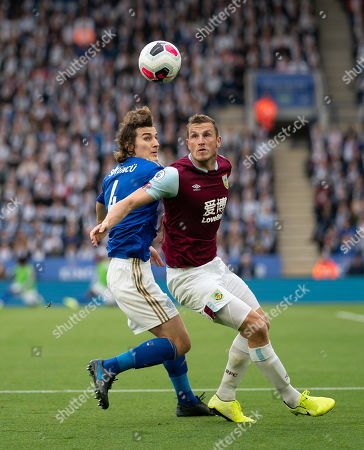 Stock Image of Caglar Soyuncu of Leicester City and Chris Wood of Burnley