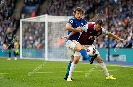 Caglar Soyuncu of Leicester City and Chris Wood of Burnley