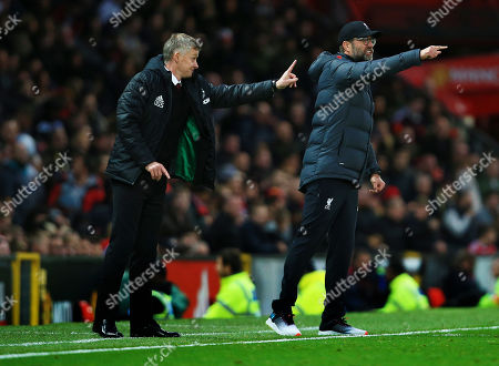 Manchester United manager Ole Gunnar Solskjaer and counterpart Jurgen Klopp of Liverpool issue instructions