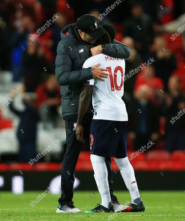 Stock Photo of Liverpool manager Jurgen Klopp hugs Sadio Mane at the end of the game