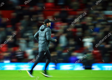 Liverpool manager Jurgen Klopp runs on to the pitch at the end of the game