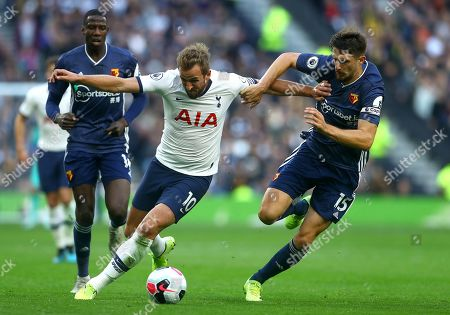 Harry Kane of Tottenham Hotspur and Craig Cathcart of Watford in action