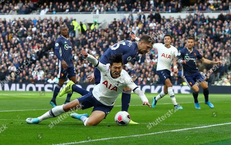 Stock Picture of Son Heung-Min of Tottenham Hotspur goes down challenged by Craig Cathcart of Watford but no penalty isc given