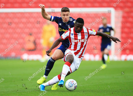 Oghenekaro Etebo of Stoke City and Tom Cairney of Fulham