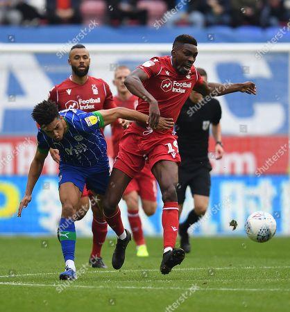 Antonee Robinson of Wigan Athletic and Sammy Ameobi of Nottingham Forest