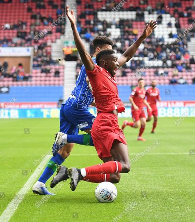 Sammy Ameobi of Nottingham Forest collides with Antonee Robinson of Wigan Athletic but no foul is given